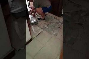 Popped tiles in Sengkang flat