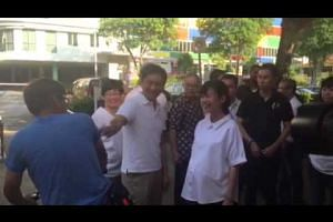 PAP's Tan Chuan-Jin and Tin Pei Ling interacting with MacPherson residents