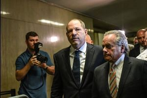 Judge drops one charge against Harvey Weinstein