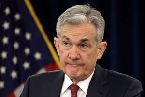 Fed lifts rates, undeterred by Trump tweets