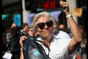 Actress Emma Thompson joins climate protest in London's Oxford Circus