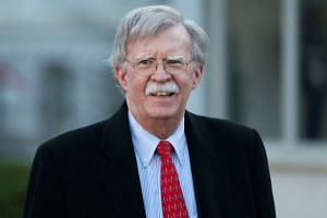 North Korea rebuilds part of a missile site, Bolton warns of more sanctions