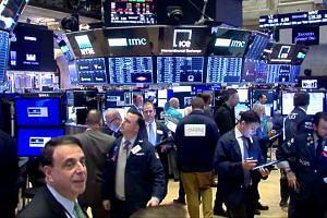 Stocks fall as Trump signals delay in China trade deal