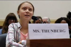 Thunberg tells lawmakers, 'listen to the science'