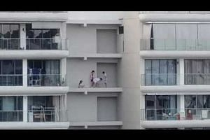 students hanging out on open ledges on the 16th floor of Riversound Residences