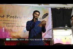 Bangladeshi engineer Rajib Shil Jibon reading an English translation of his poem