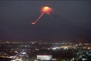 Lava spews from restive Philippines volcano