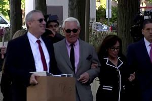 Roger Stone arrives in court as criminal trial begins