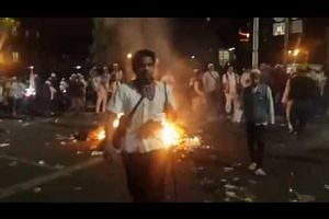 Protesters burn garbage near presidential palace in Jakarta