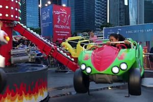 Carnival-goers enjoy the rides at the Marina Bay carnival