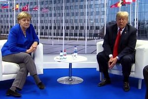 Donald Trump meets Angela Merkel at Nato after slamming Germany