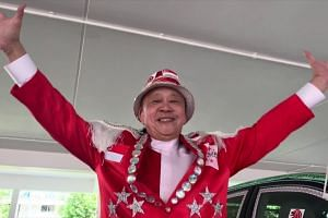Gojek driver Henry Ho's customised car and outfit for National Day 2019