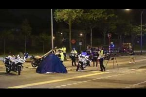 Police officers at the site of an accident at Woodlands Ave 12