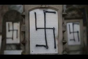 Dozens of graves desecrated in Jewish cemetery in France