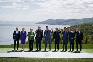 G-7 leaders all smiles at family photo-op