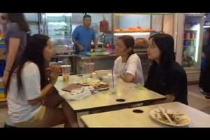 Patrons at Marsiling Mall Hawker Centre having meals without using trays