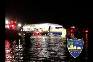 Boeing 737 slides off runway into Florida river, no fatalities