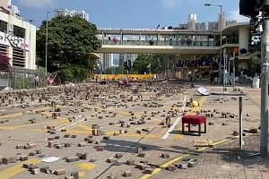 Protesters set up barriers with bricks at Baptist University in Hong Kong