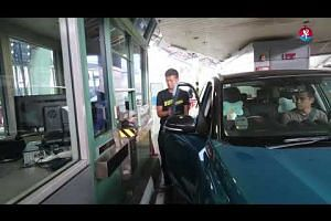 A demo of the thumbprint screening system at Woodlands Checkpoint
