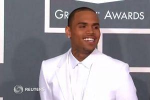 Singer Chris Brown arrested in France on suspicion of rape