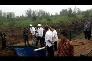 President Joko Widodo inspects canal blocking