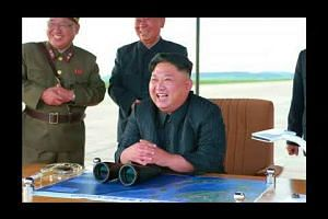 Photos released show Kim Jong Un guiding missile launch