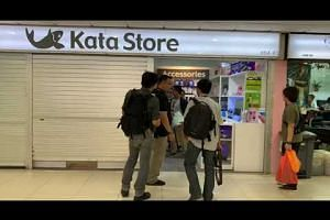 Police officers raid Kata Store