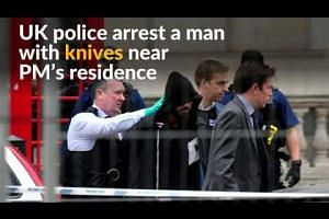 Police arrest man with knives near British PM's residence
