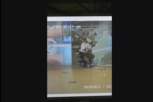 Woman crashes into galss door