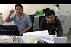 Myanmar judge sentences Reuters reporters to prison