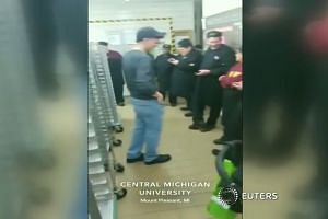 Two dead in Michigan university shooting, suspect at large