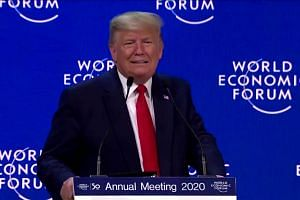 Trump denounces 'predictions of apocalypse' at Davos