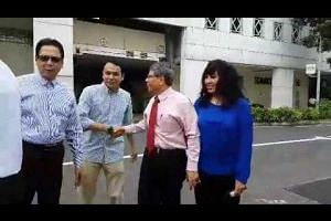 Second Chance CEO Salleh Marican and his wife arrive at the Elections Department