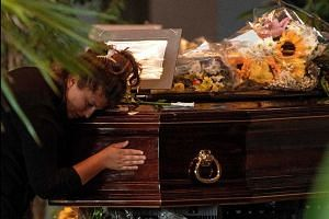 Coffins of bridge collapse victims blessed ahead of funeral