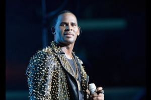 R. Kelly charged with sexual abuse: Reports