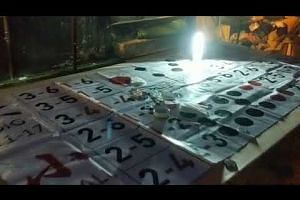 The police raids an illegal gambling den in Geylang run by secret societies