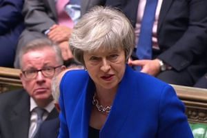 Theresa May's government wins confidence vote