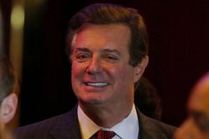 Trump ex-aide Manafort gets nearly 4 years in prison