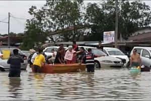 Penang residents overwhelmed by strong winds and flash floods