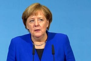 Angela Merkel strikes deal with social democrats, paving way for new government