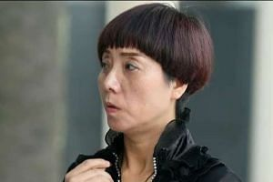 Li Hu's mother Su Mengxian leaving the State Courts