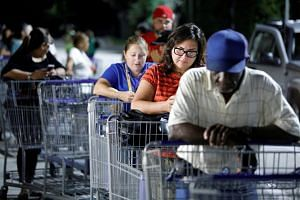 Long lines as Florida braces for Dorian
