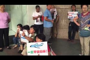 Relatives gather outside Malaysia Airlines' office in Beijing, China