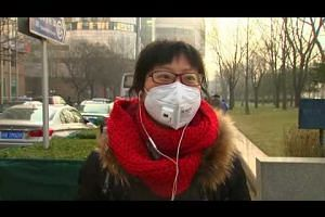 Day two of Beijing's first-time red alert for