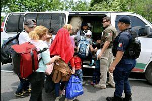 Mexican troops block migrants as tariffs loom