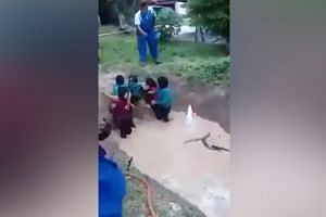 Outcry after girls made to train in pit with snake