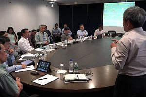 PM Lee being briefed at LTA Ops Centre