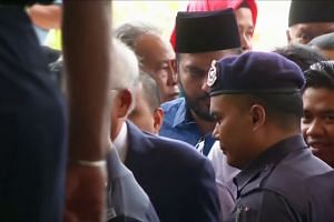 Malaysian ex-PM Najib arrives at court for 1MDB-linked graft trial