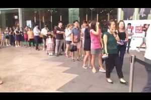 People queue for their free Milo in show of support for Nathan Hartono