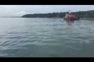 Oil spill response vehicle cleaning up oil spill off Pulau Ubin